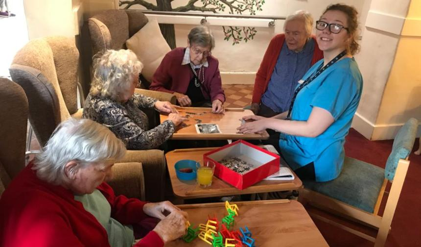 Ellie enjoying activities with care home residents