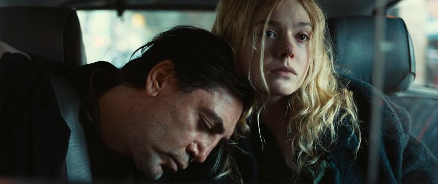 A still from the film The Roads Not Taken, with Bardem and Fanning