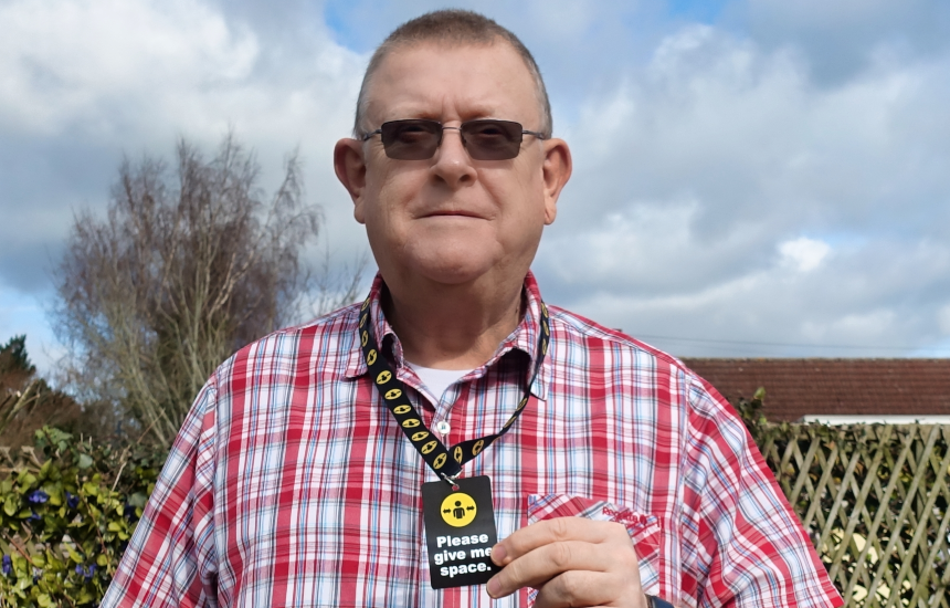Peter Middleton wearing a Please give me space lanyard