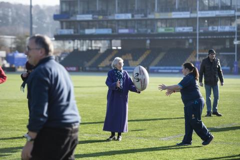 People throwing a rugby ball