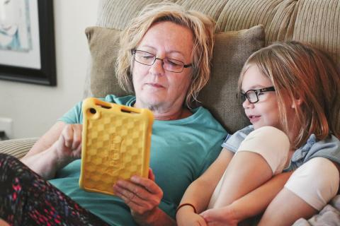 Grandma and daughter looking at an iPad