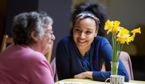 An older woman and young care home worker