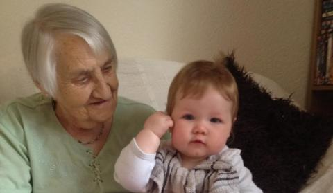 Dorothy with her great-grandchild on her lap, before coronavirus