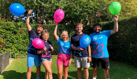 Marie's family wearing Memory Walk t-shirts and holding balloons