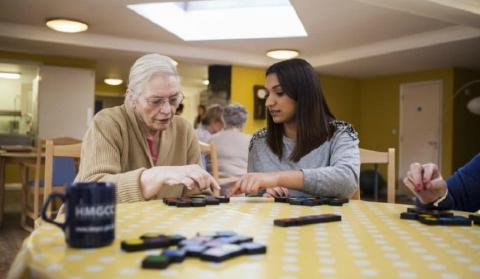 Two women in a care home playing a game
