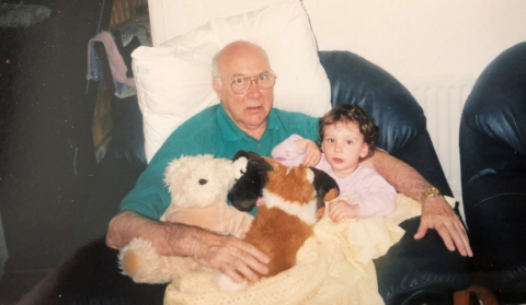 Olivia Fairhurst as a child sitting in the lap of her grandfather, Robert